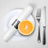 Fresh orange on plate Royalty Free Stock Images