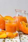 Fresh orange pumpkin and juice Royalty Free Stock Photography