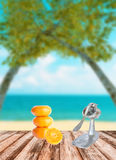 Fresh orange put on brown wooden with blurred image of beach sea blue-sky Royalty Free Stock Image