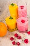 Fresh orange and raspberry smoothie drinks Stock Photos