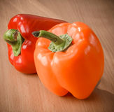 Fresh orange and red peppers Stock Photos