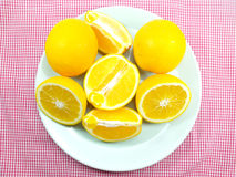 Fresh orange on Red stripes Stock Photography