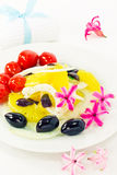 Orange salad and flowers around the plate Stock Photos