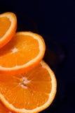 Fresh orange slice. Fresh orange on black background (fruits, food, vitamin Stock Image