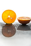 Fresh orange slice with half an orange and water drops Stock Images
