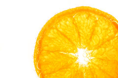 Fresh orange slice in water with bubbles Royalty Free Stock Images