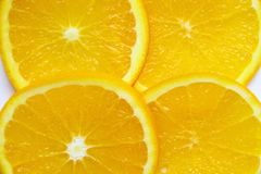 Fresh orange sliced pieces of background Stock Photo