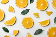Fresh orange slices and leaves on white, top view. Fresh orange slices and leaves on white background, top view royalty free stock image