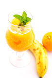 Fresh orange smoothie with mint leaf in glass isolated on white background, orange, mango, carrot or banana drink, product photogr Royalty Free Stock Photo