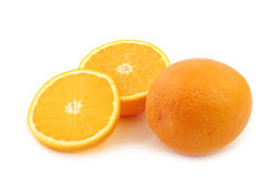 Fresh orange and some cut pieces. On a white background stock image