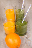 Fresh orange and spinach smoothie drink Stock Photo