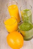 Fresh orange and spinach smoothie drink Royalty Free Stock Image