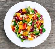 Fresh Orange, strawberry vegetables salad. on wooden table. Fresh Orange, strawberry vegetables salad. on wooden table Royalty Free Stock Photos
