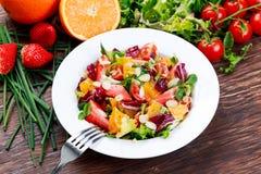 Fresh Orange, strawberry vegetables salad. on wooden table. Fresh Orange, strawberry vegetables salad. on wooden table Stock Photos