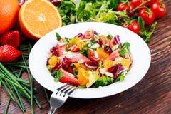 Fresh Orange, strawberry vegetables salad. on wooden table. Fresh Orange, strawberry vegetables salad. on wooden table Royalty Free Stock Photography