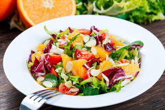Fresh Orange, strawberry vegetables salad. on wooden table. Fresh Orange, strawberry vegetables salad. on wooden table Stock Images