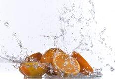 Fresh orange with water splash Royalty Free Stock Images