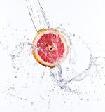 Fresh orange with water splash Stock Photos