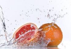 Fresh orange with water splash Royalty Free Stock Photography