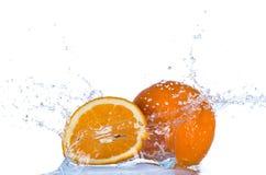 Fresh orange in water splash on white backround Royalty Free Stock Photo