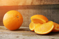 Fresh orange on wooden background for healthy. Organic or clean fruit from orchard in the market. Clean fruit and drink for health Royalty Free Stock Image