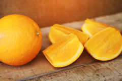 Fresh orange on wooden background for healthy. Organic or clean fruit from orchard in the market. Clean fruit and drink for health Stock Images