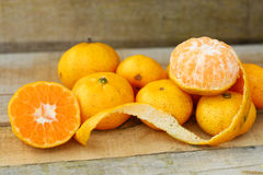 Fresh orange on wooden table in dining room. Healthy fruit for lose weight ,Fresh oranges on wooden background Royalty Free Stock Image