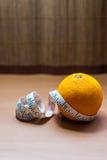 Fresh orange wrapped with measuring tape Stock Photo