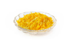 Fresh orange zest in small glass bowl on white background Royalty Free Stock Photography