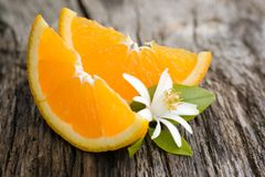 Fresh oranges. And blossom on wooden ground stock photo