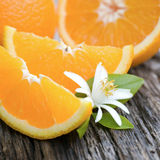 Fresh oranges. And blossom on wooden ground stock image
