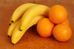 Fresh oranges and bananas a wooden Stock Photography