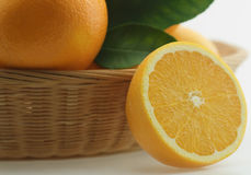 Fresh oranges in basket Stock Photo