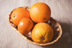 Fresh oranges in the basket Royalty Free Stock Photo