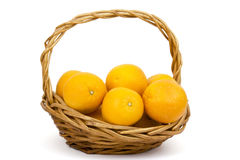 Fresh oranges in a basket Royalty Free Stock Photos