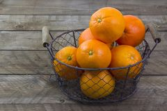 Fresh oranges in a basket stock photo