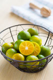 Fresh oranges in a basket. And on wooden background Royalty Free Stock Photos