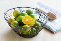 Fresh oranges in a basket. And on wooden background Stock Image