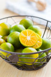 Fresh oranges in a basket. And on wooden background Stock Images