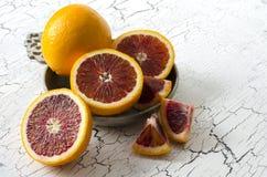 Fresh oranges. Fresh blood oranges on cracked wood  background Royalty Free Stock Photography
