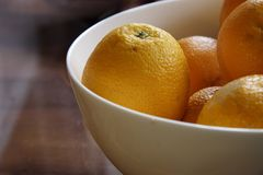 Fresh oranges in a china bowl Stock Image