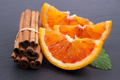 Fresh oranges and cinnamon sticks Stock Image