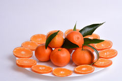 Fresh oranges and clementines with leaves cut in slices Royalty Free Stock Photography