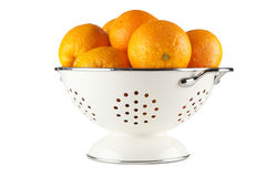 Fresh oranges in a colander Stock Photo
