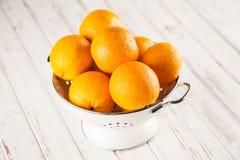 Fresh oranges in a colander Stock Photos