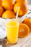 Fresh oranges in a colander Stock Images