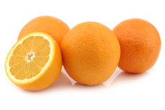 Fresh oranges and a cut piece Stock Photo