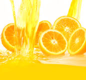 Fresh Oranges Falling In Juice Royalty Free Stock Photography