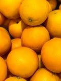 Fresh oranges at fruit department in supermarket. Stock Images