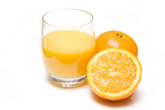 Fresh oranges and glass Royalty Free Stock Image